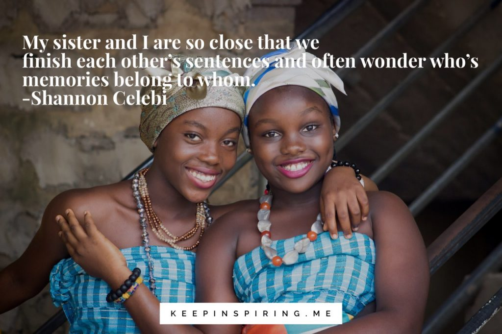 Two sisters from Lagos in matching dresses and headscarves smile together