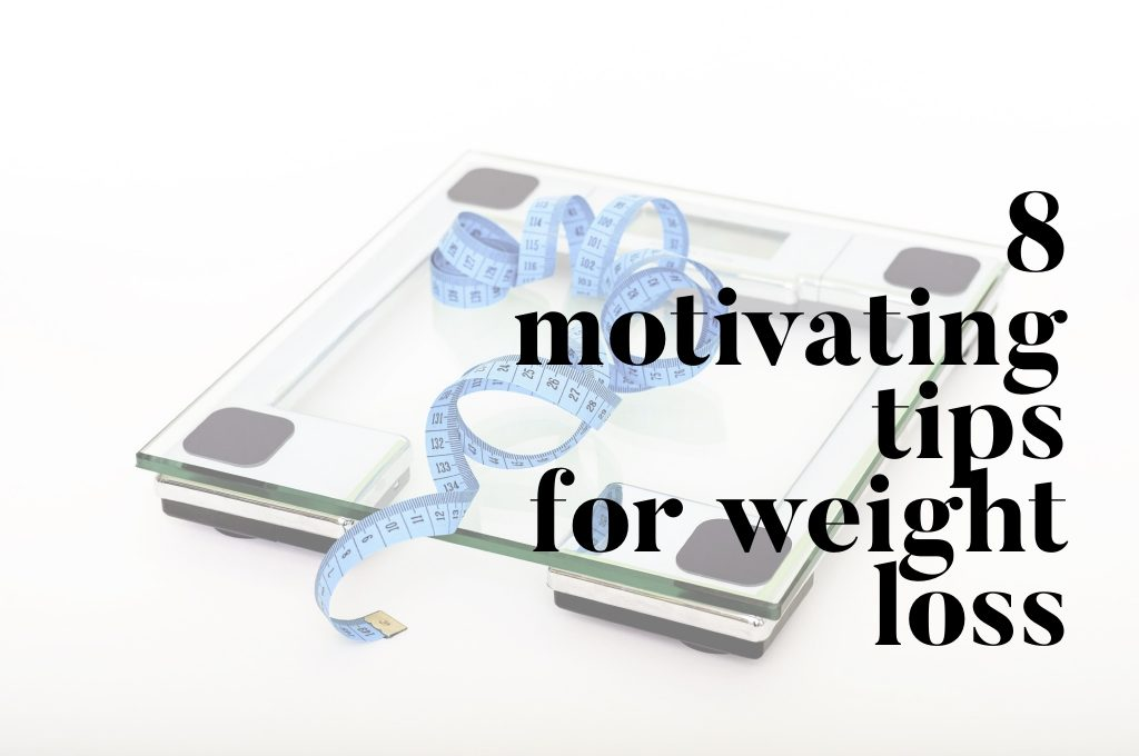 a glass weighing scale and blue measuring tape on white background