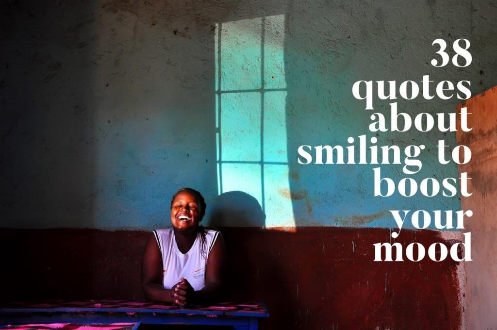 A smiling girl in front of a brightly colored red and turquoise wall in Ghana