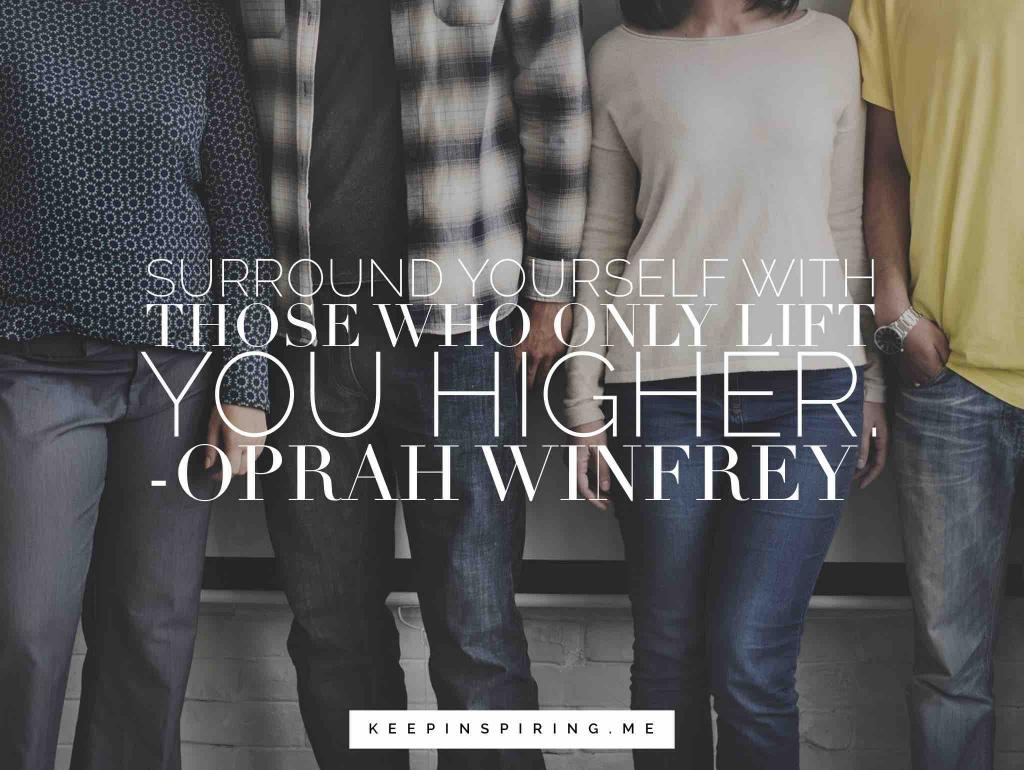 Four friends sharing an Oprah Winfrey quote about positivity