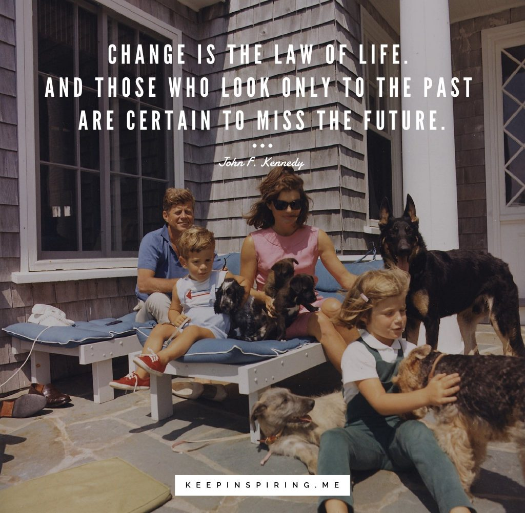 JFK and Jackie Kennedy playing with their two children and six dogs