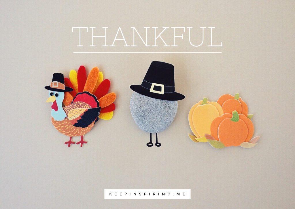 A turkey, pilgrim, and pumpkin patch made of felt cutout pieces