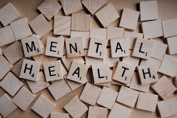 wooden scrabble tiles face down under the words mental health