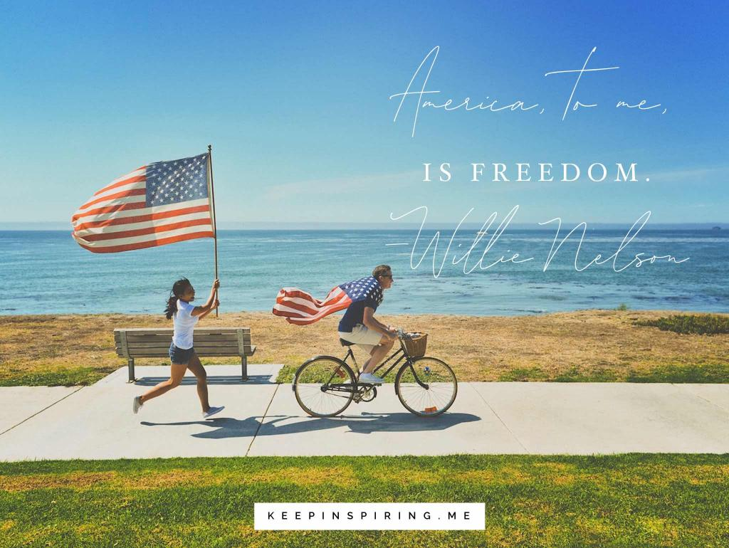 A kie rider draped in a US flag and a woman running with another flag by the sea