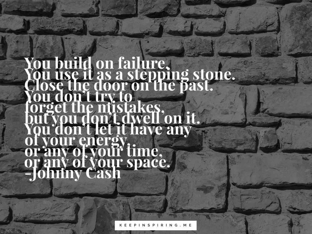 A dark gray stone wall with a Johnny Cash quote