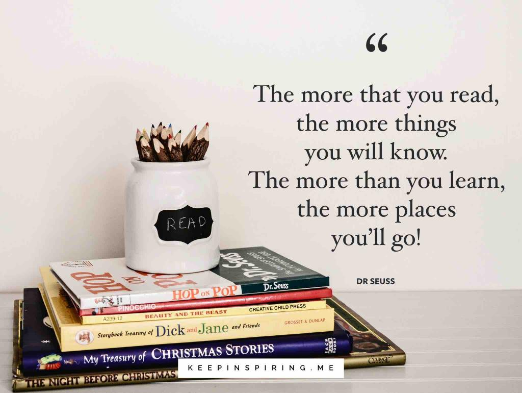 A quote about reading and a stack of children's books on a gray school desk