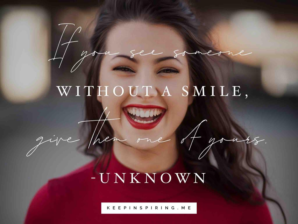 A brunette girl with red Revlon lipstick and a big smile