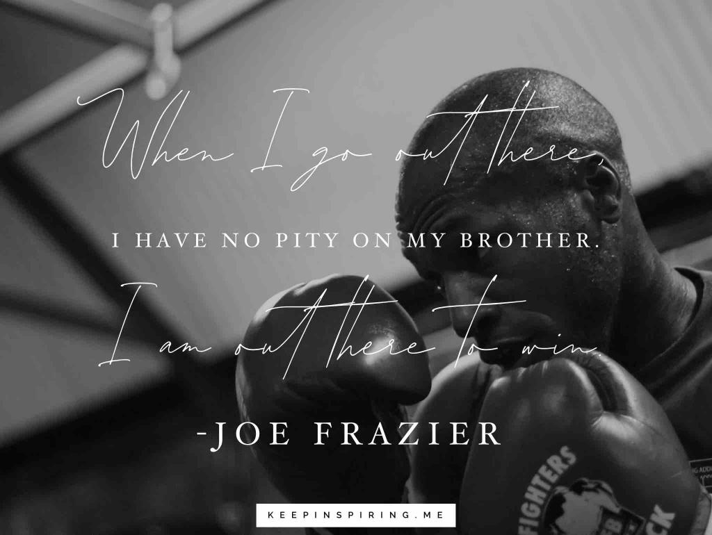 A boxer behind his gloves thinking of a Joe Frazier quote to get inspired